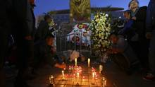 People light candles in front of wreaths outside Kunming railway station after a knife attack, Yunnan province, March 2. (WONG CAMPION/REUTERS)