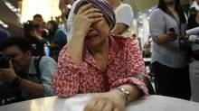 A woman, who said she believed her sister was on Malaysia Airlines flight MH17, cries as she waits for more information about the crashed plane at Kuala Lumpur International Airport in Sepang July 18, 2014. The Malaysia Airlines Boeing 777 was brought down over eastern Ukraine on Thursday, killing all 295 people aboard and sharply raising the stakes in a conflict between Kiev and pro-Moscow rebels in which Russia and the West back opposing sides. (OLIVIA HARRIS/REUTERS)