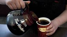 A cup of Tim Hortons coffee is poured in Toronto on May 14 2010. The iconic coffee-and-doughnut chain has put up for sale its Gulfstream 100 business jet following its recent merger with U.S. fast-food giant Burger King Worldwide Inc. (Chris Young/The Canadian Press)