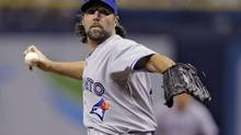 Toronto Blue Jays starting pitcher R.A. Dickey delivers to the Tampa Bay Rays during the first inning of a baseball game Tuesday, Sept. 2, 2014, in St. Petersburg, Fla. (Chris O'Meara/AP)