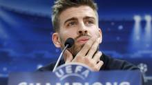 Barcelona's soccer player Gerard Pique attends a news conference at Joan Gamper training camp near Barcelona, March 11, 2013. Barcelona and AC Milian will play their Champions League soccer match on Tuesday. (ALBERT GEA/REUTERS)