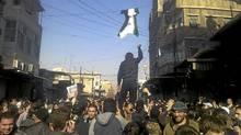 Demonstrators protest against Syria's President Bashar al-Assad in al-Midan district in Damascus Dec. 19, 2011. (Reuters/Reuters)
