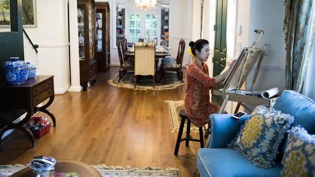 Cindy Liu draws at her home in Vancouver.