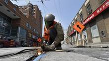 The biggest problem with streetcar routes is rooted in materials engineering – since steel and concrete expand at different rates, streetcar tracks destroy the roads with clockwork regularity. Then come the construction crews. (Fred Lum/The Globe and Mail)
