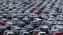 Newly assembled 2013 Ford Escapes sit on plant lots ready to be shipped out to dealers at the newly transformed Louisville Assembly Plant in Louisville, Ky. (JOHN SOMMERS II/REUTERS)