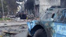 Two damaged armoured military vehicles are seen after clashes between President Bashar al-Assad forces and Free Syrian Army (FSA) in Cairo square near Khaldiyeh area in Homs Feb. 4, 2012. (REUTERS/REUTERS)