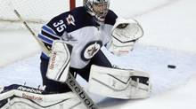 Winnipeg Jets goalie Al Montoya makes a glove save during the first period of an NHL game against the Chicago Blackhawks, Sunday, Jan. 26, 2014, in Chicago. (Charles Rex Arbogast/AP)