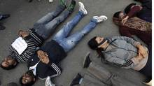 Demonstrators lie on a road during a protest in New Delhi, December 29, 2012. A woman whose gang rape sparked protests and a national debate about violence against women in India died of her injuries on Saturday, promoting a security lockdown in New Delhi and an acknowledgement from India Prime Minister that social change is needed. (Adnan Abidi/REUTERS)