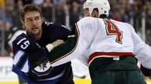 Minnesota Wild defenceman Clayton Stoner and Tanner Glass fight during the second period at MTS Center. (Bruce Fedyck/US PRESSWIRE/Bruce Fedyck/US PRESSWIRE)