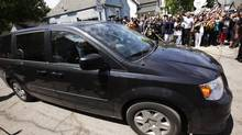 A van containing Gina DeJesus arrives at her home in Cleveland. Ms. DeJesus, Michelle Knight, Amanda Berry and Berry's 6-year-old daughter escaped a Cleveland home where they were held captive. DeJesus, now 23, vanished at 14 in 2004. (JOHN GRESS/REUTERS)