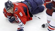 Washington Capitals' Alex Ovechkin (8), of Russia, reaches for the puck after falling on the ice during the third period of an NHL preseason hockey game against the Columbus Blue Jackets in Washington, Monday, Sept. 26, 2011. (Charles Dharapak/AP)