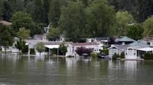 Rising water threatens homes along Mara Lake in Sicamous, B.C. Tuesday, June 26, 2012. (Jonathan Hayward/THE CANADIAN PRESS)