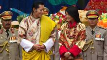 King Jigme Khesar Namgyel Wangchuck smiles at his bride Jetsun Pema during the purification marriage ceremony in the historical Punakha Dzong in Punakha, Bhutan on Oct. 13, 2011. (Paula Bronstein/Getty Images)