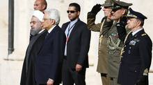 Iran President Hassan Rouhani (L) poses with the Italian President Sergio Mattarella at the Quirinale presidential palace in Rome, Italy, January 25, 2016. (TONY GENTILE/REUTERS)