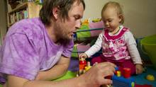 "Mike McNair a ""superdad"" plays with his daughter, Charlee at home in Vancouver April 20, 2011. (JOHN LEHMANN/THE GLOBE AND MAIL)"