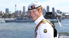 Britain's Prince Harry smiles while onboard the HMAS Leeuwin as the ship participates in the 2013 International Fleet Review in Sydney, Australia Saturday, Oct. 5, 2013. (Ryan Pierse/AP)