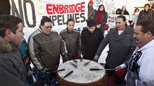 Traditional drummers Thundering Spirit take part in a rally outside the Enbridge Northern Gateway oil sands pipeline project hearings at the Wingate hotel in Edmonton on Jan. 23, 2012. (JASON FRANSON/THE CANADIAN PRESS)