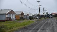 Town of Fort McPherson, NWT. Federal, provincial and territorial ministers are due to meet in January with the various partners to come up with a plan to clear away institutional barriers to projects that would provide reliable electricity in indigenous communities. (Fred Lum/The Globe and Mail)
