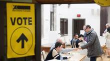 Voters cast ballots on election day in Toronto, Ontario, Canada, on Monday, Oct. 19, 2015. (James MacDonald/Bloomberg)