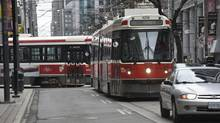 Westbound King streetcars line up in traffic near Spadina Avenue. (FRED LUM/THE GLOBE AND MAIL)