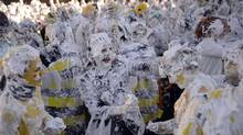 Students from Scotland's St. Andrews University work up a lather as they participate in the school's annual Raisin Weekend event. (RUSSELL CHEYNE/REUTERS)