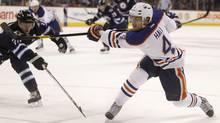 Edmonton Oilers' Taylor Hall gets a shot off in front of Winnipeg Jets' Tobias Enstrom in Winnipeg, Feb. 27, 2012. (Trevor Hagan/The Canadian Press/Trevor Hagan/The Canadian Press)