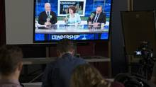 Reporters watch the B.C. election live radio leaders debate in Vancouver on Thursday. (JONATHAN HAYWARD/THE CANADIAN PRESS)