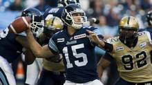 Toronto Argonauts quarterback Ricky Ray prepares to throw the ball against the Winnipeg Blue Bombers during first half CFL action in Toronto on Wednesday, July 18, 2012. (Aaron Vincent Elkaim/THE CANADIAN PRESS)