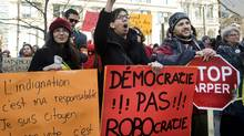 Demonstrators gather in Montreal, Sunday, March 11, 2012, protesting the 'Robocall' election fraud scandal. (Graham Hughes/The Canadian Press/Graham Hughes/The Canadian Press)