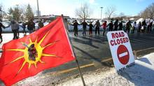 Idle No More protestors march and block the International Bridge between the Canada and U.S. border near Cornwall Ont., on Jan. 5 2013. (FRED CHARTRAND/THE CANADIAN PRESS)