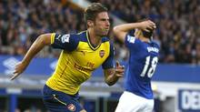 Arsenal's Olivier Giroud celebrates after scoring a goal against Everton during their English Premier League soccer match at Goodison Park in Liverpool, northern England August 23, 2014. (ANDREW YATES/REUTERS)