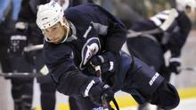 Winnipeg Jets player Zach Bogosian takes a shot during the NHL teams training camp in Winnipeg September 17, 2011. (Reuters)