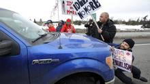 A motorist tries to drive through a barricade during an Idle No More protest outside Edmonton on Jan. 16, 2013. (DAN RIEDLHUBER/REUTERS)