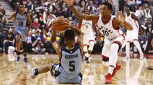 DeMar DeRozan, right, battles for the ball with Andrew Harrison during the first half on Wednesday. (Mark Blinch/THE CANADIAN PRESS)