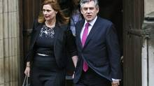 Former British Prime Minister Gordon Brown leaves the High Court with his wife Sarah after giving evidence at the Leveson Inquiry, London, Monday, June 11, 2012. (Tim Hales/AP)