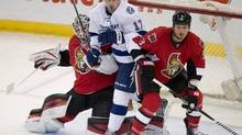 Lightning centre Alex Killorn squeezes between Senators goalie Robin Lehner and defenceman Marc Methot. (Adrian Wyld/The Canadian Press)