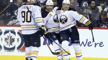 Buffalo Sabres forward Kyle Okposo (21) celebrates after scoring on Winnipeg Jets goaltender Michael Hutchinson during second period NHL action in Winnipeg, on Oct. 30, 2016. (Jason Halstead/THE CANADIAN PRESS)