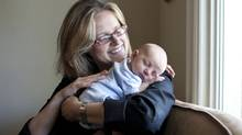 Alison Gibbins, see here with four-week Galen on May 11, 2012, is one of many Toronto parents struggling to find a daycare solution. (Moe Doiron/Moe Doiron/The Globe and Mail)