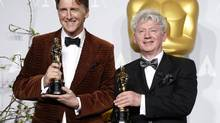 Director Malcolm Clarke, right, with producer Nicholas Reed and their Oscars for best documentary short film for The Lady in Number 6: Music Saved My Life. (MARIO ANZUONI/REUTERS)
