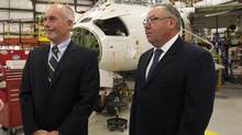 Joe Randell, left, president of Chorus Aviation, and Premier Darrell Dexter tour the Jazz Aviation heavy maintenance base in Enfield, N.S. on Monday, July 16. The provincial government is giving the company a five-year $16.5 million funding package as the company consolidates its heavy maintenance operations in Nova Scotia. (Andrew Vaughan/THE CANADIAN PRESS)