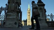 People make their way toward Parliament Hill in Ottawa on Sept. 19, 2011, as the the House of Commons resumes sitting after the summer break. (Sean Kilpatrick/THE CANADIAN PRESS)