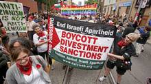 Anti-Israel marchers in last year?s Toronto gay pride parade marched up Church Street. Controversy has swirled over their inclusion. (Michael Hudson/CP)