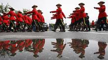 Members of the RCMP march in regimental memorial parade to honour peace officer Rod Lazenby in High River, Alta., Friday, Aug. 24, 2012. Lazenby, a former Mountie, was killed in the line of duty on Friday, August 10, 2012 near Priddis, Alta. (Jeff McIntosh/THE CANADIAN PRESS)
