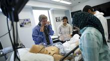 Third year medical students take part in a simulated medical situation at the Sunnybrook Canadian Simulation Centre at Sunnybrook Health Sciences Centre in Toronto, November, 2013. (Kevin Van Paassen/The Globe and Mail)
