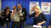 Far right party National Front leader Marine Le Pen poses for photographers before addressing reporters at the party's headquarters in Nanterre, west of Paris, on May 25. (Remy de la Mauviniere/AP)