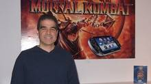 Ed Boon, one of the co-founders of Mortal Kombat, stands in front of a poster advertising his latest game, Mortal Kombat for PlayStation Vita, at a media event in Toronto, February 17, 2012 (Chad Sapieha)