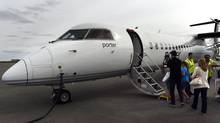 Passengers board a Porter Airlines flight at the Greater Moncton International Airport heading for Billy Bishop Toronto City Airport with a stop in Ottawa, on June 12, 2014. (Fred Lum/The Globe and Mail/The Globe and Mail)