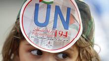 """A Palestinian girl wearing a replica of a military uniform bears a sticker on her forehead, which reads: """"UN 194 Palestinian State"""", during a rally in support of Palestinian President Mahmoud Abbas' bid for statehood recognition at the United Nations, at Mar Elias refugee camp in Beirut September 23, 2011. (SHARIF KARIM/REUTERS)"""
