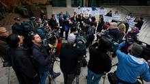 B.C. Civil Liberties Association lawyer Alison Latimer, centre, speaks to the media outside the B.C. Court of Appeal in Vancouver on Oct. 10, 2013, after the court reversed a lower court ruling that said Canada's assisted-suicide ban violated the charter rights of gravely ill Canadians. (DARRYL DYCK/THE CANADIAN PRESS)