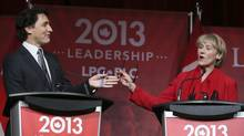 Federal Liberal Party leadership candidates Justin Trudeau, left, and Joyce Murray take part in the final leadership debate in Montreal on March 23, 2013. Mr. Trudeau and Ms. Murray butt heads during the debate over vote-splitting strategies. (CHRISTINNE MUSCHI/REUTERS)